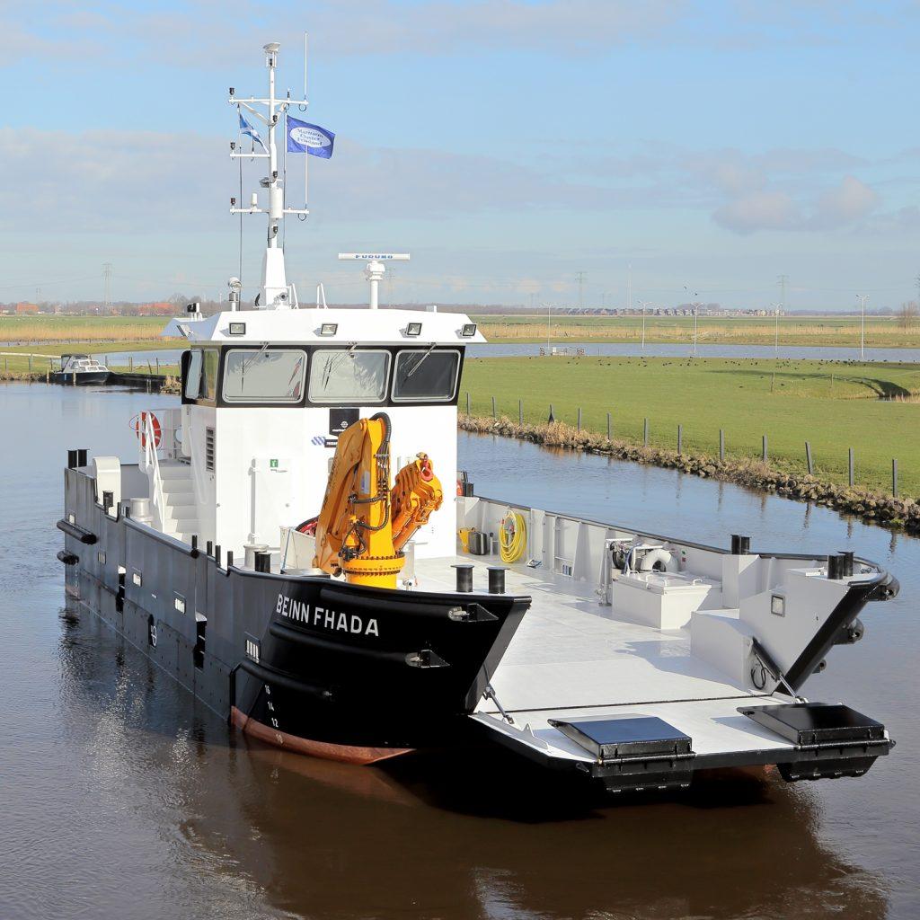 Ship thee Beinn Fhada sailing through a channel